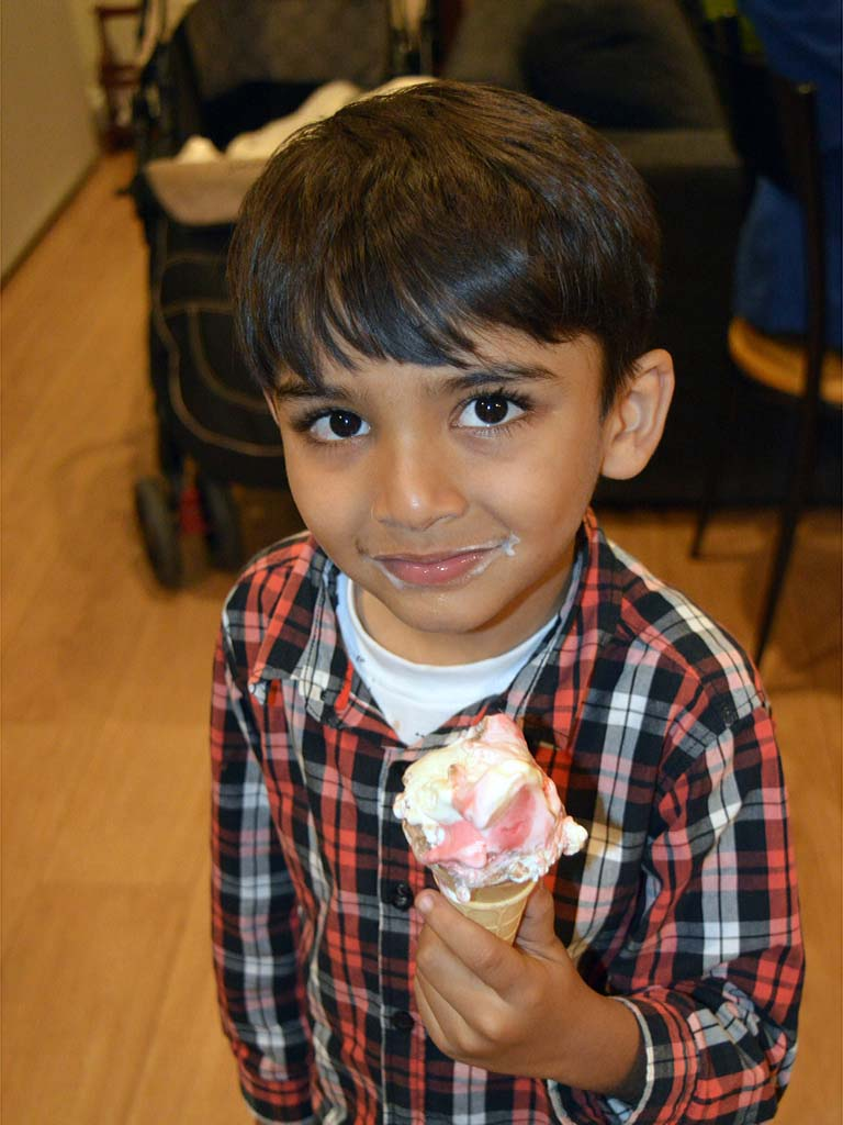 photo of young boy eating ice-cream